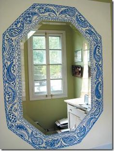 Frame made with blue sharpie  Would love to try this with scraps of leather that had been stamped and painted.