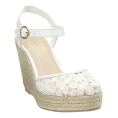 """Lace flower espadrille with adjustable buckle closure.  Measurements: wedge 4"""" and platform 1"""".  This style is available exclusively @ Nine West Stores & ninewest.com."""
