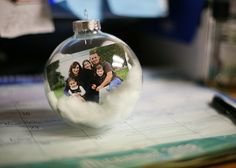 """""""Basically, I bought a box of large clear ornaments. I rolled up a wallet sized photo and put it in t Looking for great handmade products for gifts or personal collectibles."""""""