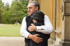 Actor Jim Carter and his co-star Raquel Cassidy, who plays Baxter, share a tender embrace on set