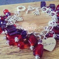 Stunning #Valentine Charm Bracelet in rich red luxury Indian glass and purple glass cubes #charm #bracelet #red #purple #glass #jewellery #unique #silver #handmade #madeinuk #fashion #accessory #accessories #beads #madetoorder