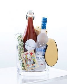bloodymary bucket-- bloody mary mix, grey goose, deck of cards, wasabi peas  sleep mask... CUTE!