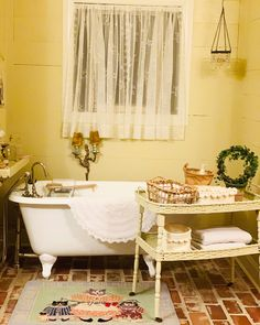 Brick floors, a claw foot tub, and wooden walls make for a charming farmhouse moment! Brick Flooring, Floors, Cottage Bathrooms, Cottage Farmhouse, Wooden Walls, Clawfoot Bathtub, Home Tiles, Wood Walls, Flats