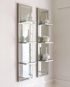 Mirrored Shelf Wall Panel at Neiman Marcus. - This is so elegant and simple and probably a pain to clean and keep it smudge free!