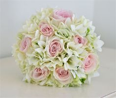 modern white bouquets | Bouquet of roses, freesias and lisianthus in palest pinks, greens and ...