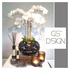 Phalaenopsis in vase   Linari Opale   eichholtz hurricanes   for sale @ GSD'sign for more info; info@gsdsign.nl  #shellshape #phalaenopsis #Linari #eichholtz #luxuryliving #interiordesign #accessories #homedecoration
