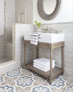 A cool, grey modern farmhouse bathroom
