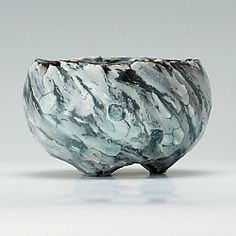 Matthew Blakely  |  Stoneware wheel-thrown bowl with three feet, fired in a gas kiln and reduced. What makes this pot different is the pink crystals that have formed on the glaze inside the bowl.