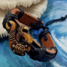 Tribal Sea Turtle Faux Bone Surfer Leather Bracelet Makau - Endurance Prosperity Tribal Sea Turtle F Leather Cuffs, Black Leather, Endurance, Shark Tooth Necklace, Leather Choker Necklace, Leather Wristbands, Surfer, Braided Bracelets, Braided Leather