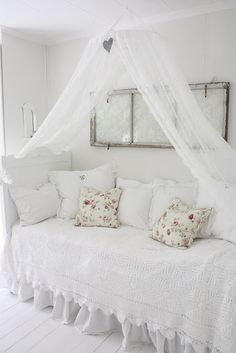 So pretty!!!  Twin bed used as a daybed, with a canopy and a salvaged window as wall art.  Love!!!