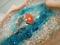 A personal favourite from my Etsy shop https://www.etsy.com/listing/126697412/handmade-silver-ring-with-faceted