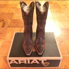 NWT Ariat Dandy Cowboy Boots Size 8 These are AMAZING cowboy boots by Ariat. They are a size 8 and run large which is why they have never been worn and have remained in the box. They are gorgeous, well-made, and very comfortable. Ariat Shoes Winter & Rain Boots