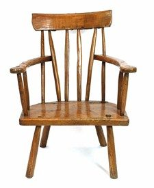 A late 19th century Irish sycamore stick back armchair