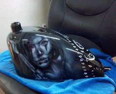 airbrushed and metal modified bobber tank with a macko muse chicano girl
