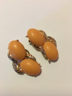 A personal favorite from my Etsy shop https://www.etsy.com/listing/266110613/vintage-peach-colored-clip-on-earrings