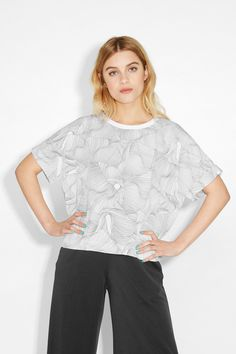 This billowy t-shaped blouse is actually the handiest clothing item ever. It walks that awesome line between casual and polished, and can be easily styled in either direction. Wide folded hems and slight ribbing round the neck finish off this dandy top with modern perfection.  colour: print perfection In a size small the chest width is 120 cm and the length is 53 cm. The model is 173 cm and is wearing a size small.