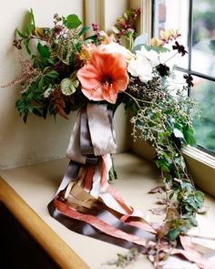 Dripping, draping dramatic cascading bouquet. Fall colors for a fall wedding.