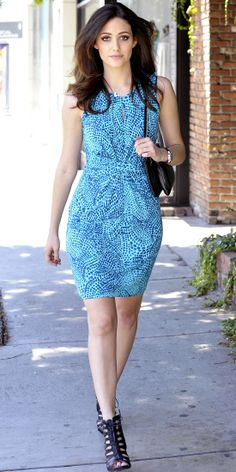 Rossum stepped out in a blue ceramic print wrap dress from the new Banana Republic x Issa collection. She completed her look with a black shoulder bag and lace-up booties.