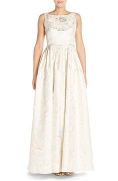 Adrianna Papell: http://www.stylemepretty.com/2016/01/10/budget-wedding-dresses-1000-dollars/