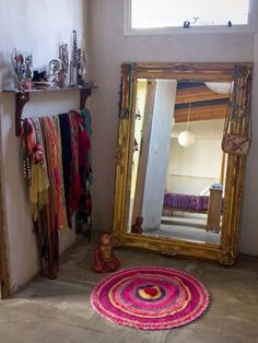 *Use a rod to hang scarves on display. [Moon to Moon: The Bright Bohemian Home of.... Pato and Pablo in Buenos Aires]
