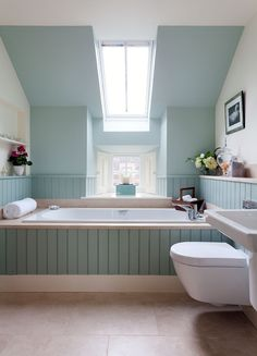 Tongue & groove blue green aqua bathroom by interior designer Sally Homan for www.robertson-lindsay.com