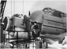 Rolls Royce engineers fitting a Tyne turboprop to an Avro Lincoln testbed