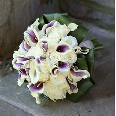 Calla Lillies and white roses  http://www.beachweddingsbydeb.com