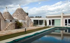 The southeastern region of Apulia, known for its unusual conical structures, has become one of Italy's most popular markets for second homes. Rectangular Pool, Religious Architecture, Small Windows, Southern Italy, Real Estate Agency, Lounge Areas, Home Buying, Swimming Pools, Traditional