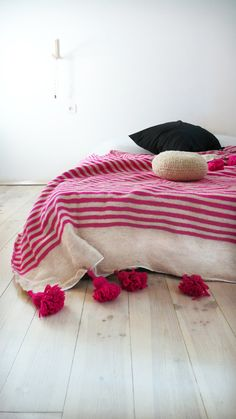 Image of Moroccan POM POM Wool Blanket -  Pink Stripes - guest bed