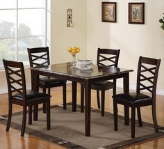 5PC dining set features X back dining chairs with durable dark brown leather-like vinyl upholstered seating and faux marble top dining table. Finished in a brown cherry.Special Price: $543.00