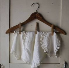 vintage linen doilies with crochet trim. I like this display idea
