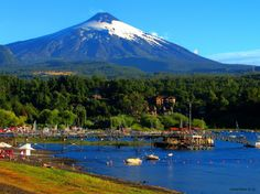 Pucón, Chile;  This exotic town which hugs an awe inspiring lake and  sits in the shadow of an active volcano is known as Chile's adventure capital because its location is perfect for many recreational activities like snow skiing and kayaking.