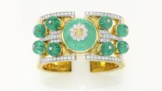 David Webb . Vegas cuffin yellow gold platinum, diamonds and carved emeralds