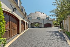 traditional garage and shed by Harold Leidner Landscape Architects