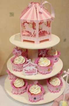 Pink cupcakes at a carousel birthday party!  See more party planning ideas at CatchMyParty.com!