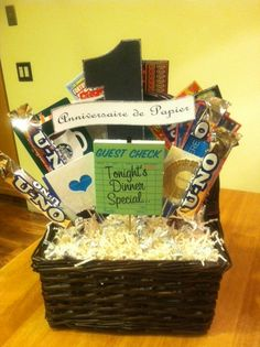 """1st Wedding Anniversary Gift Basket: Dianna made this gift basket for her husband to celebrate their first anniversary, which is the """"paper"""" anniversary."""