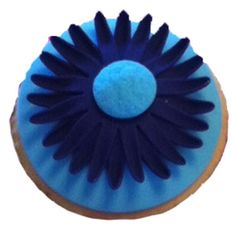 It's a double-sided cupcake cutter! One side is a circle- the other is a daisy.