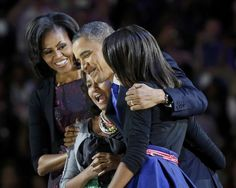 U.S. President Barack Obama hugs his daughters Malia (R) and Sasha (2L) as First lady Michelle Obama looks on during his election night victory rally in Chicago, November 7, 2012. REUTERS/Larry Downing