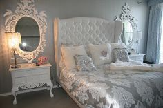 Gorgeous. but Im not a fan of that damask bedding. Kinda the look I want for my room. Luv headboard and nightstands with mirrors above.