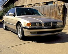 Restored 1998 BMW 740i with new chrome front grilles.