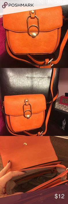 🔴New🔴. Fashion Crossbody 👜 Nice orange to make any outfit pop!  Nice touch of color, adjustable strap, gold hardware Bags Crossbody Bags