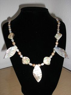 Genuine Freshwater pearls/white/peach/genuine mop shell leafs and nuggets on Etsy, $13.75