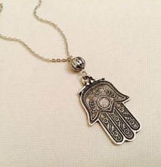 Check out this item in my Etsy shop https://www.etsy.com/listing/252419408/new-silver-hamsa-hand-necklace-antique