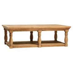 """Complete with spooled legs and a carved cornice top, this reclaimed pine coffee table anchors your living room with timeless style.  Product: Coffee tableConstruction Material: Reclaimed pineColor: NaturalDimensions: 18"""" H x 55"""" W x 33"""" D"""