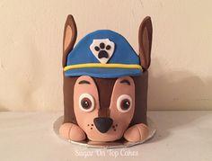 Chase from Paw Patrol smash cake Facebook.com/sugarontopcakes Sugarontopcakesandsweets.com