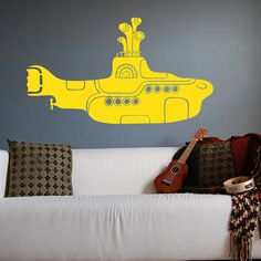 We all live in a yellow submarine: http://www.etsy.com/listing/73796298/the-beatles-yellow-submarine-wall-decal?ref=sr_gallery_8_search_submit=_search_query=The+Beatles_search_type=handmade_facet=handmade