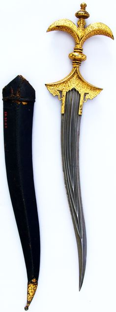 Indian chilanum, 18th century, iron, gold, leather, H. with sheath 16 3/8 in. (41.6 cm); H. without sheath 15 1/4 in. (38.7 cm); H. of blade 10 13/16 in. (27.5 cm); W. 3 9/16 in. (9 cm); D. 1 in. (2.5 cm); Wt. 11.4 oz. (323.2 g); Wt. of sheath 1.3 oz. (36.9 g), Met Museum.