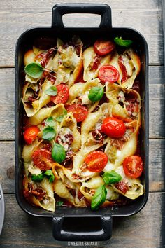 Baked pasta shells filled with artichokes, prosciutto and gruyere