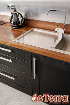 Our Super Skilled Team Created A Bespoke Cut Out In This Full Stave Black  American Walnut Worktop To Perfectly Fit This Ultra Modern Stainless Steel  Sink.