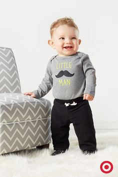 Super cute and trendy, this Little Man long-sleeved bodysuit features a delightful moustache and lets everyone know who's boss. Add the comfy lounger pants and this outfit is made for an all-day holiday celebration with family and friends.